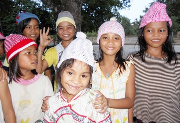 Children at Vinh Son 5 wearing new woolen hats 2013