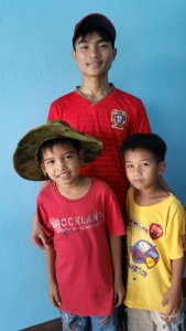 Boi with brother Mit in hat and cousin Chung