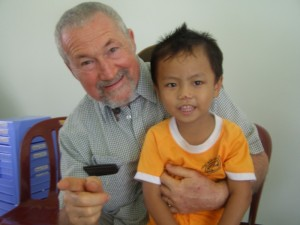 Brian Smith from Townsville with 3 year old Phuoc Vinh Son 3 Orphanage